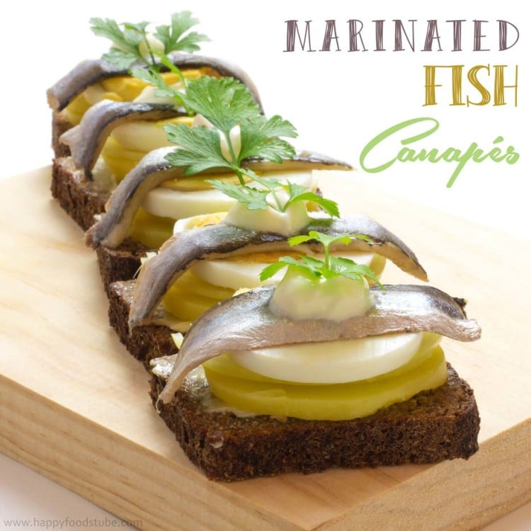 Marinated Fish Canapés - The combination of dark bread, potato, fish, onion and crème fraiche tastes just divine! These canapes are a very popular party food in Estonia, Sweden and Finland | happyfoodstube.com