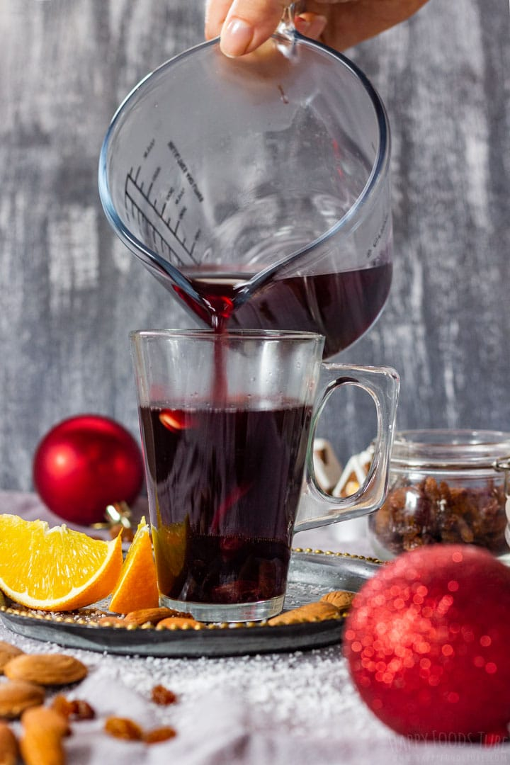 Pouring mulled wine to the glass