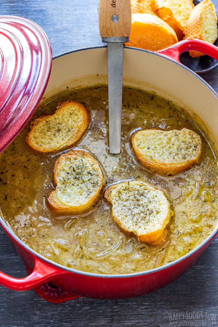 French onion soup and bread covered with cheese floating on top