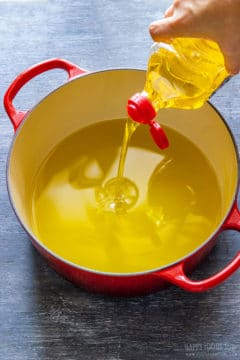 Pouring oil for frying