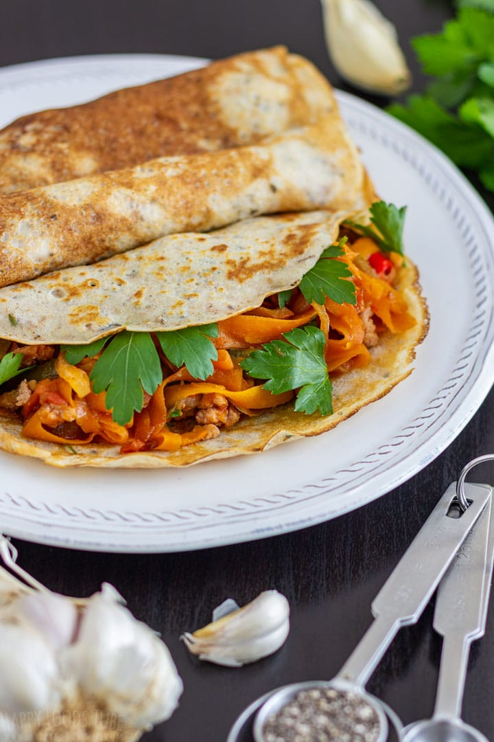 Filled savory crepes made with with herbs and garlic