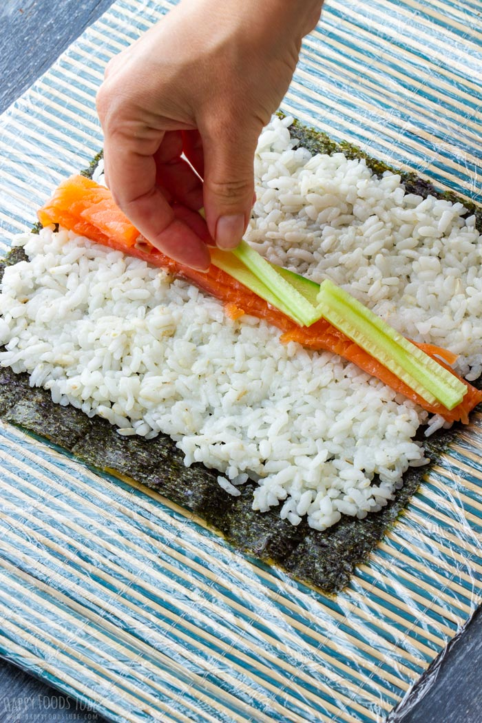 How to make Homemade Sushi Step 2 - Place your fillings neatly in the middle of the rice