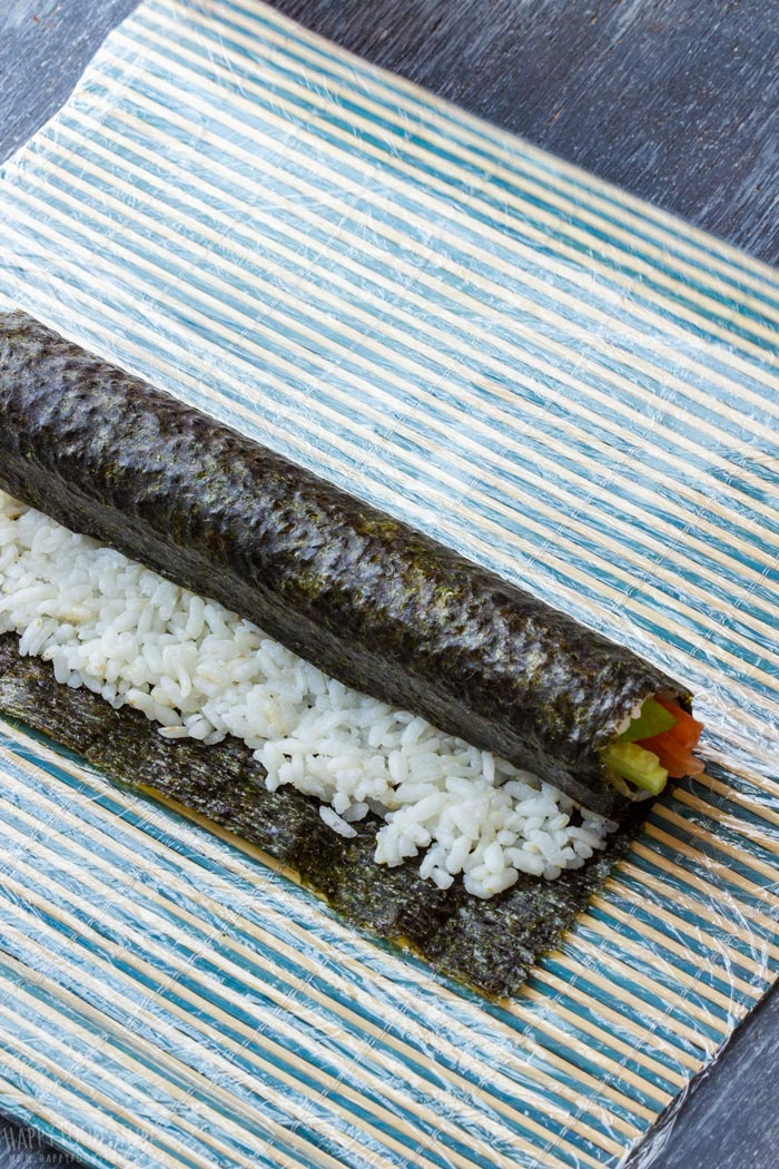 How to make Homemade Sushi Step 4 - Half rolled sushi roll