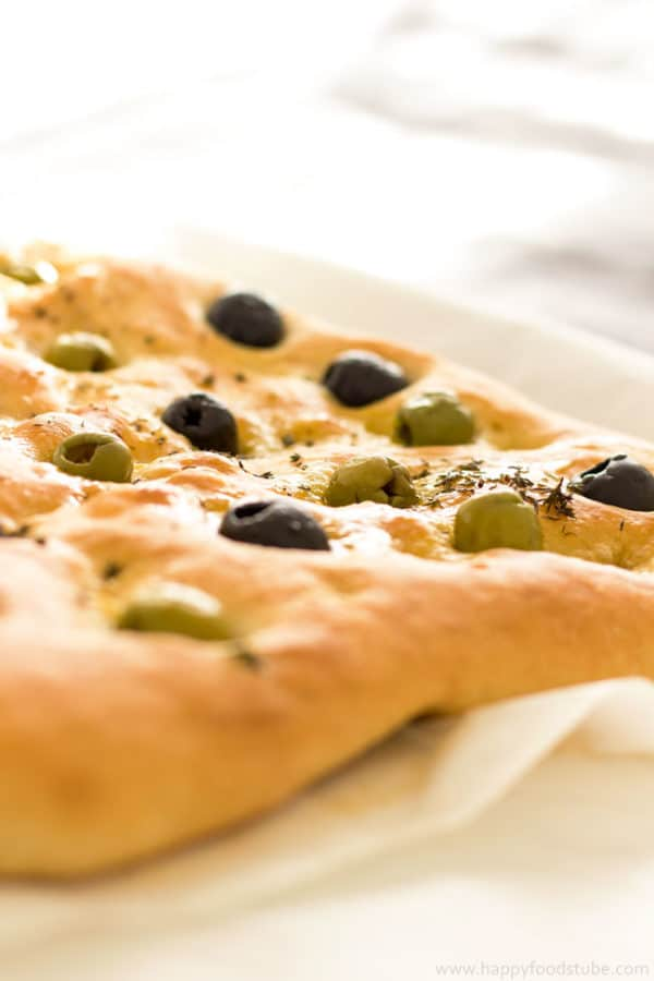 Focaccia Bread with Olives & Thyme Recipe - easy flat oven-baked Italian bread recipe, homemade delicious bread recipe, Italian food, baking | happyfoodstube.com