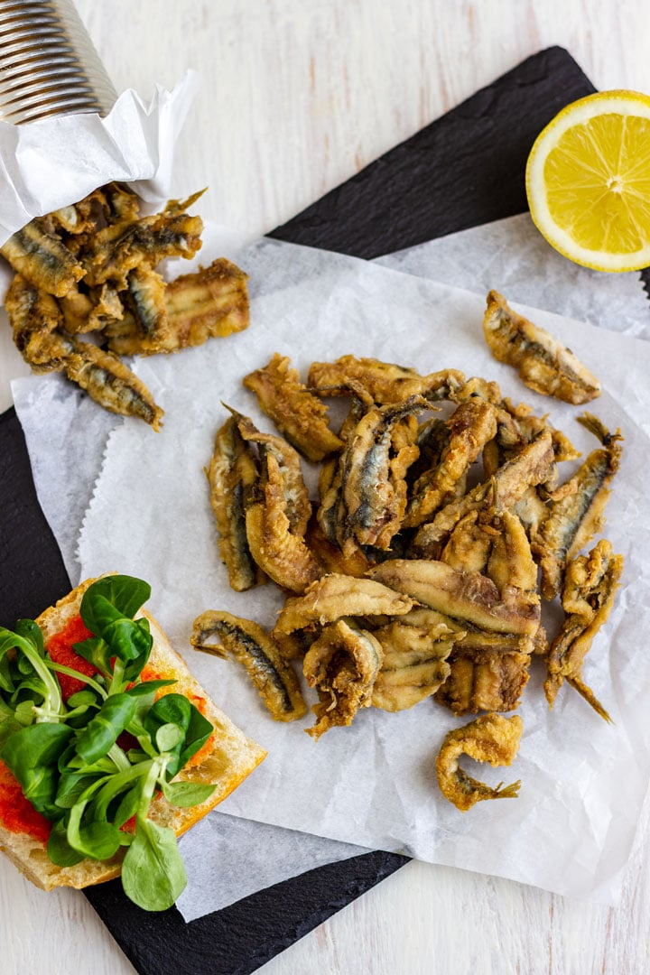 Deep fried anchovies with wedge of lemon