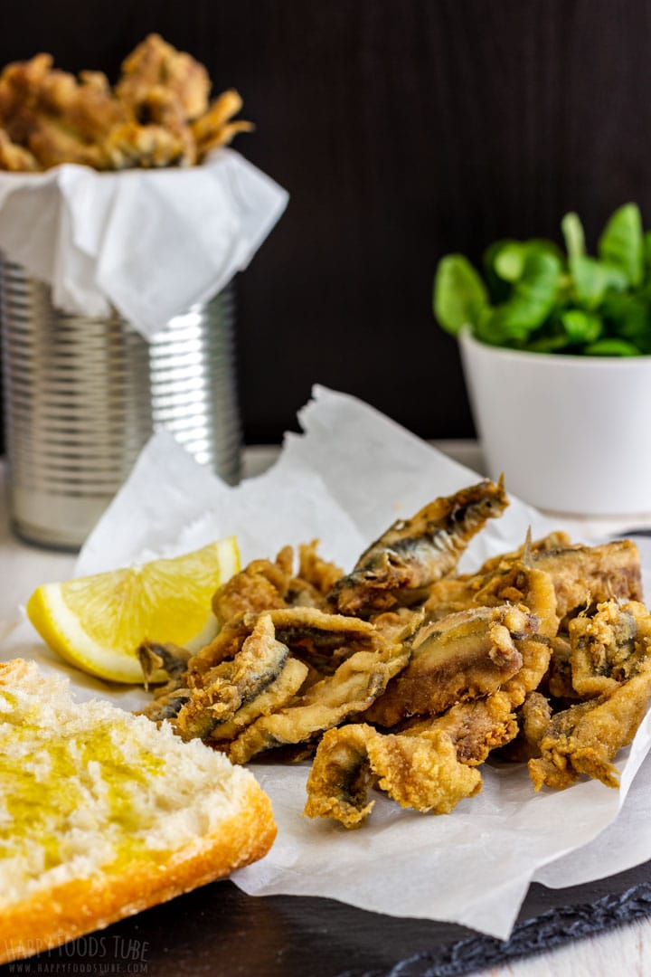 Plate of fried anchovies with fresh bread