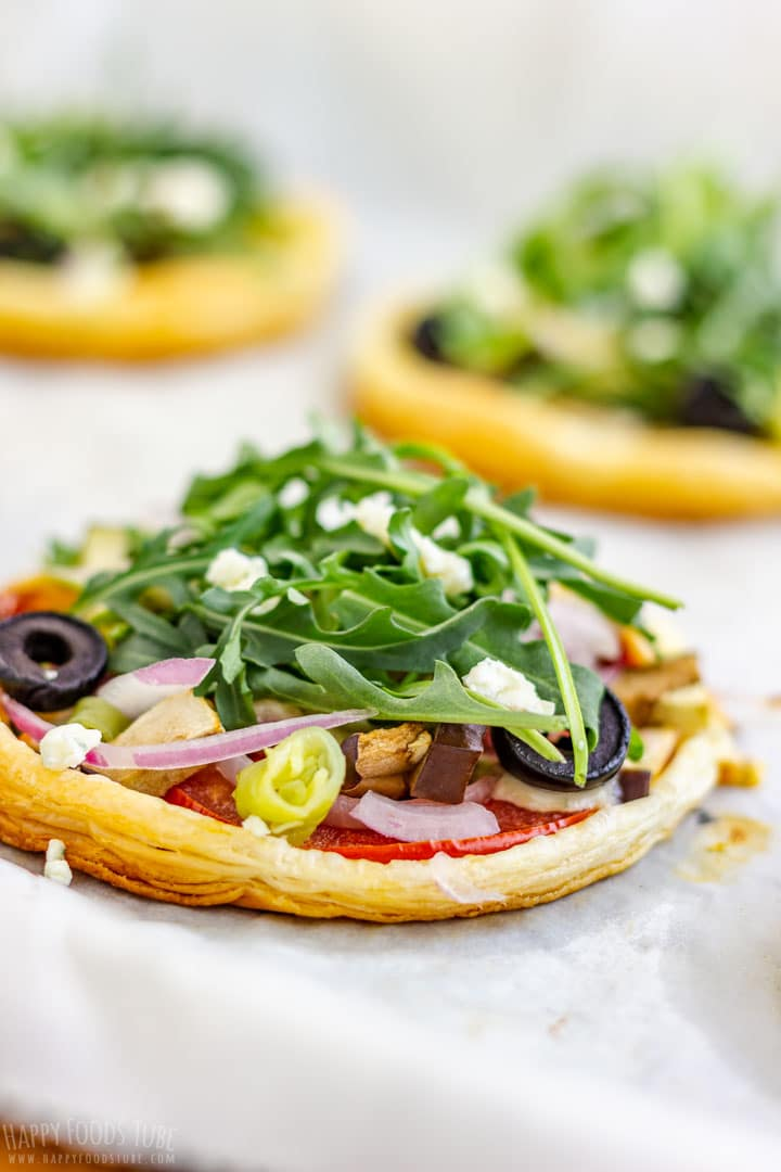 Mini Vegetarian Puff Pastry Pizzas Topped with Arugula