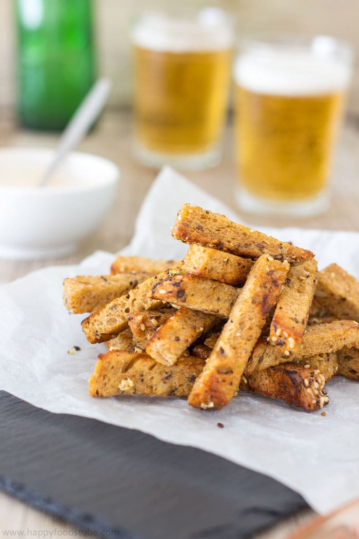 Dry-Fried Garlic Sourdough Soldiers (Küüslauguleivad) - An incredible snack recipe that goes hand in hand with beer. Crispy stripes of sourdough bread dry-fried and coated in olive oil + garlic   happyfoodstube.com
