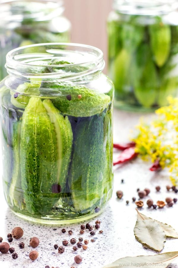 Let's pickle some cucumbers! This spicy sweet and sour dill pickles recipe is our favorite and never disappoints! | happyfoodstube.com