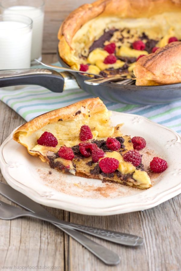 German Pancakes (Dutch Baby Pancakes) are the best pancakes you can get! Buttery, oven baked pancakes topped with raspberries, lemon curd & melted chocolate! Super easy recipe! | happyfoodstube.com