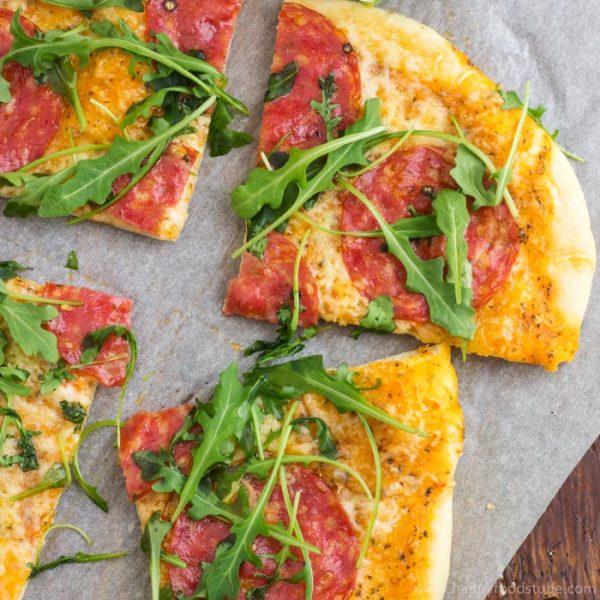Salami pizza with cheese and arugula | happyfoodstube.com