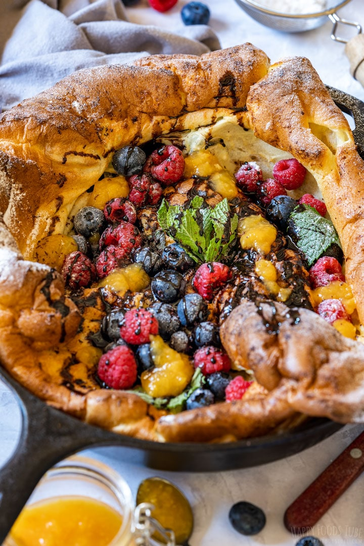 Oven baked German pancake with choclate sauce and berries