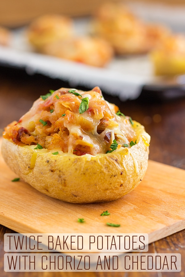 Twice Baked Potatoes with Chorizo and Cheddar can be enjoyed as an appetizer, side dish or a main. These super easy Twice Baked Potatoes are loaded with cheddar cheese, chorizo and seasonings. #happyfoodstube #twicebaked #potatoes #chorizo #cheddar #recipe #sidedish #lunch #dinner #cheese #cooking