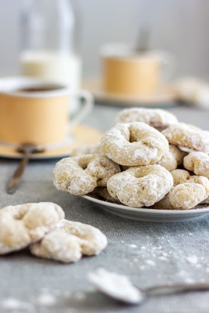 Traditional Spanish white wine cookies with cup of coffee on the table
