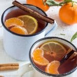 Indulge yourself in a cup of Mulled Mixed Fruit Cider with Mandarins! This warm drink made with mixed fruit cider and rum is perfect for cold days! | happyfoodstube.com