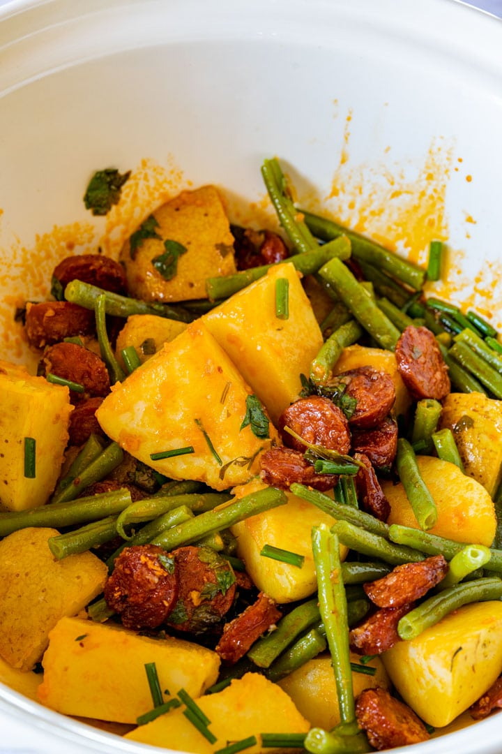 Boiled potatoes, chorizo and green beans in the mixing bowl