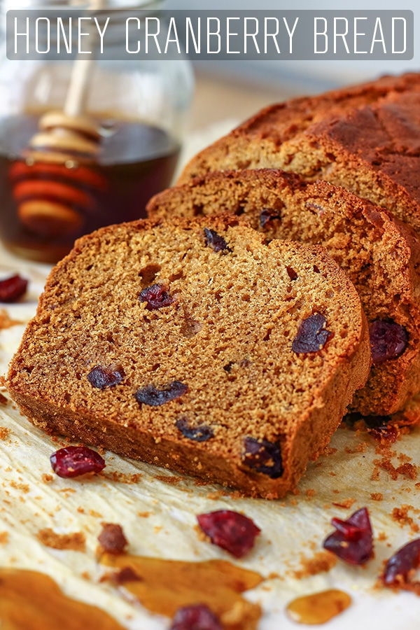 This honey cranberry bread is a delicious quick bread. Made from scratch, with a 10 minute preparation it is the perfect loaf for busy families. Homemade honey bread with cranberries. #happyfoodstube #honey #cranberry #bread #recipe #quickbread #loaf #baking