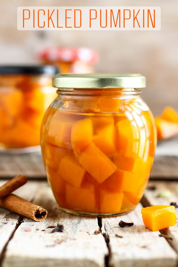 Pickled pumpkin is the perfect side dish for turkey dinner or any meat-based meals. It's sweet with a hint of sourness and tastes of cardamom, cinnamon and cloves. #happyfoodstube #pickled #pumpkin #canning #preserving #recipe #marinated #homemade