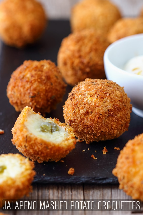 Mashed potato croquettes with jalapenos are quick leftover appetizers. Vegetarian recipe, ready in 30 minutes or less. How to make mashed potato croquettes. #happyfoodstube #croquettes #mashedpotato #recipe #vegetarian #leftover #jalapeno #cheese #potatoballs #potatomash