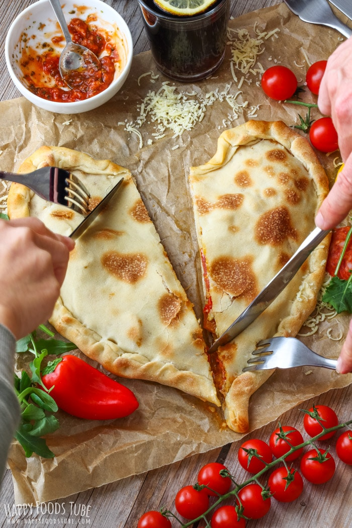 Two persons eating Heart Shaped Pizza Pocket