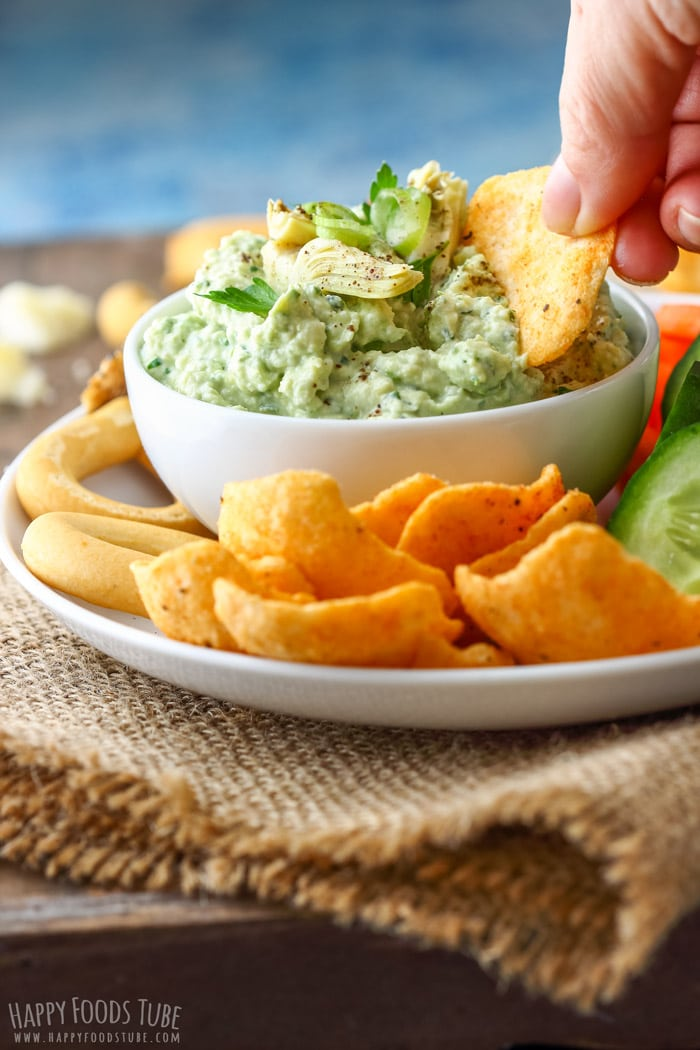 Dipping cracker to the Artichoke Heart Dip