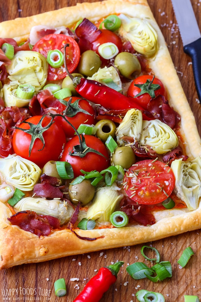 Homemade Artichoke Tart with prosciutt, tomatoes, olives and spring onion