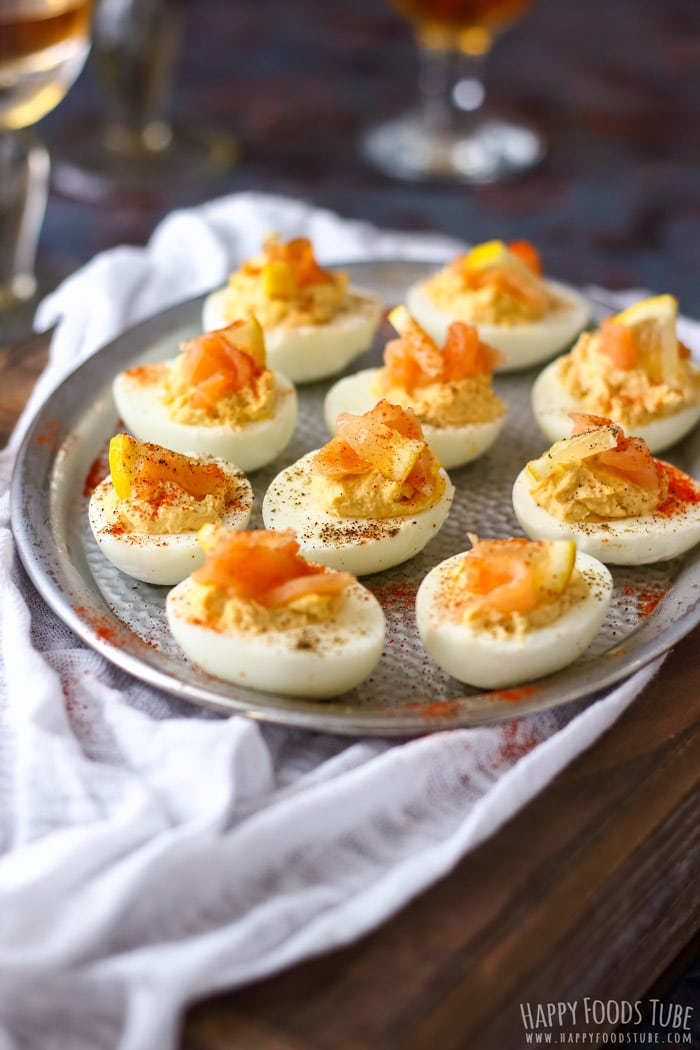 Deviled Eggs topped with smoked salmon and paprika