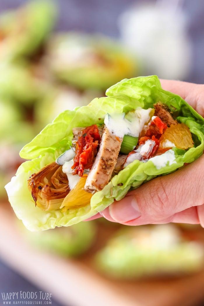 Mediterranean Chicken Lettuce Wraps on the hand closeup