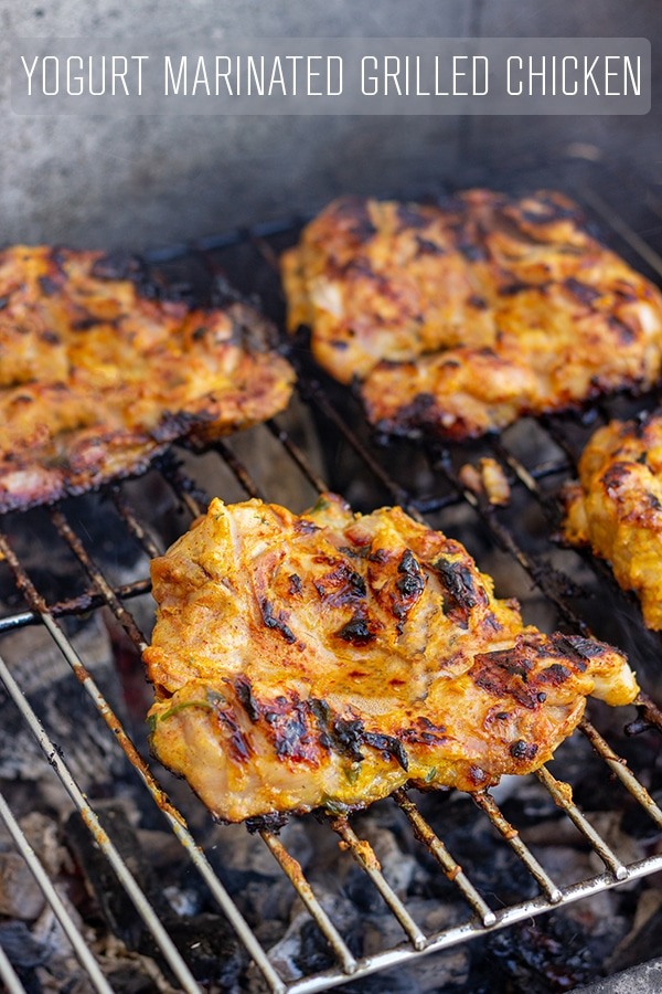 Kick off the grilling season with this yogurt marinated grilled chicken. Chicken thighs stay tender and juicy thanks to homemade yogurt marinade. Perfect for outdoor entertaining! #grilled #chicken #thighs #recipe #yogurt #marinade #bbq #grilling #homemade