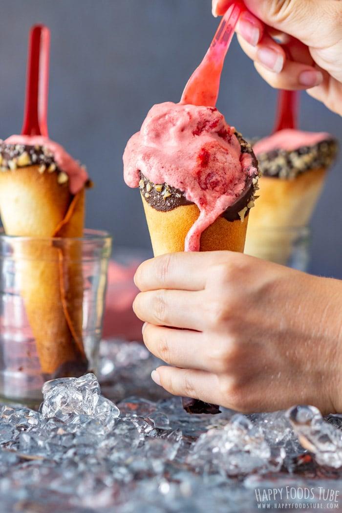 Spooning Homemade Strawberry Ice Cream