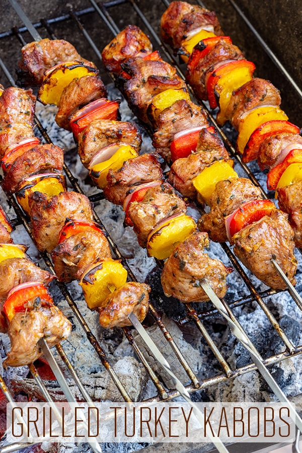 This is an easy recipe for tender, grilled turkey kabobs. Served over pasta, rice or your favorite salad, these healthy turkey skewers are a must-try this summer. #happyfoodstube #grilled #turkey #kabobs #kebabs #skewers #barbecue #bbq #grilling #recipes #outdoorcooking #marinade