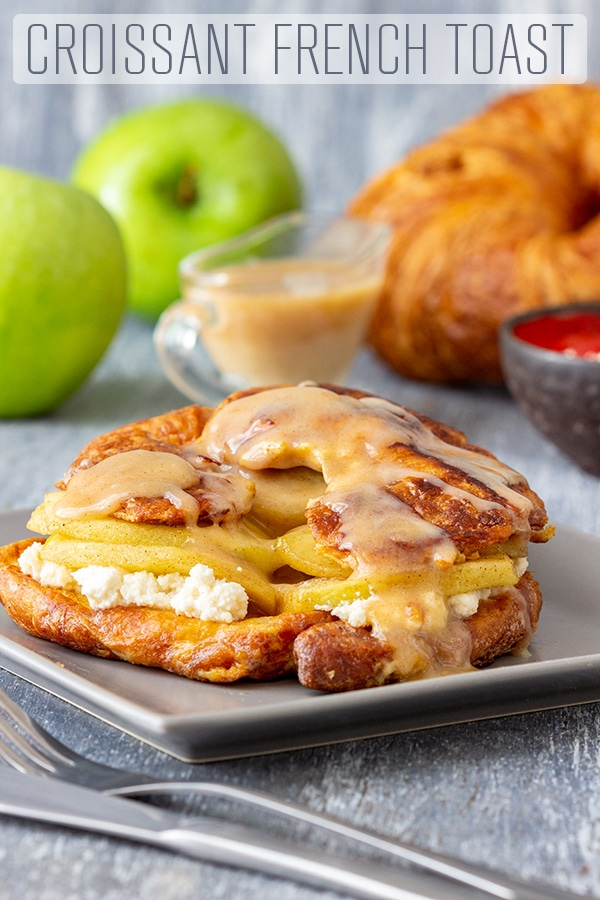 Treat yourself or your loved ones to this rich and decadent breakfast! Croissant French toast is filled with apple compote, maple ricotta and topped with warm cinnamon sauce. #happyfoodstube #croissant #frenchtoast #breakfast #recipe #french #toast #homemade