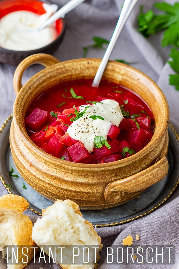 Instant Pot Borscht made from scratch is a delicious winter soup. This is a vegetarian version with an easy prep and hassle-free cooking thanks to the pressure cooker. #happyfoodstube #instantpot #borscht #recipe #beet #soup #pressurecooker #cooking #homemade #vegetarian