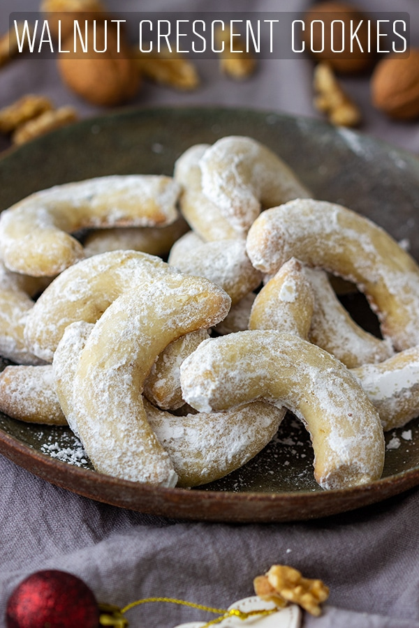 Buttery, melt-in-your-mouth walnut crescent cookies are easy to make and taste divine. Covered in powdered sugar they are perfect for the holiday season and also make a great gift. #happyfoodstube #walnut #crescent #cookies #recipe #baking #holidays #sugar #sweet