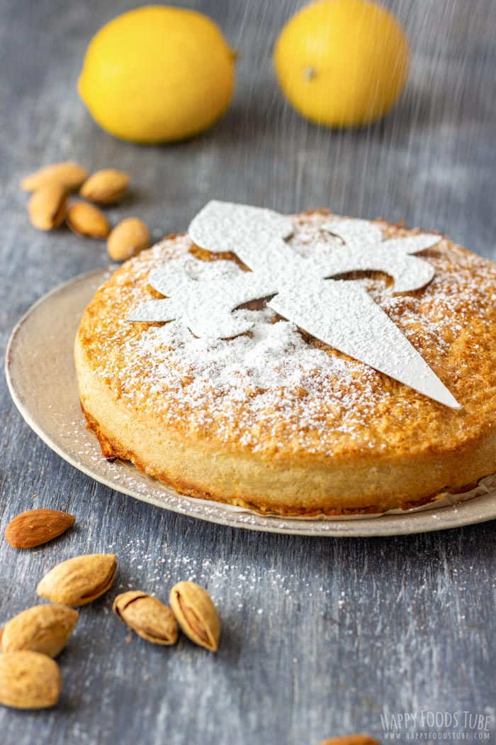 Dusting the Spanish Almond Cake with Powdered Sugar