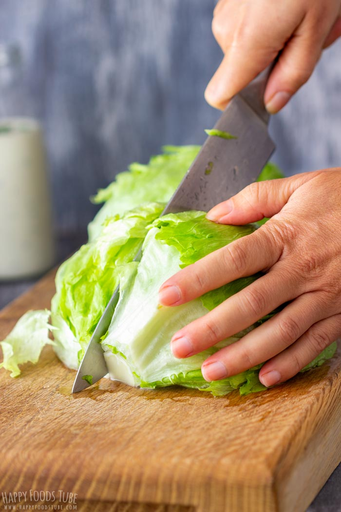 Process Shots of Wedge Salad Cutting the Lettuce