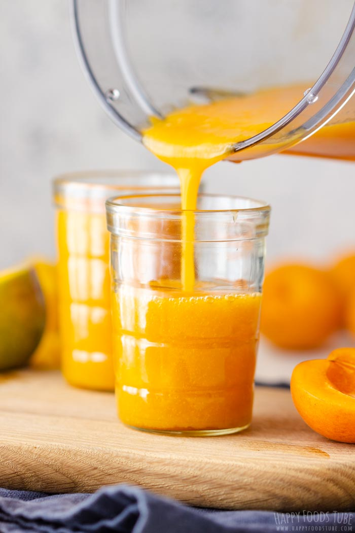 Pouring Freshly Made Apricot Mango Smoothie to the Glass