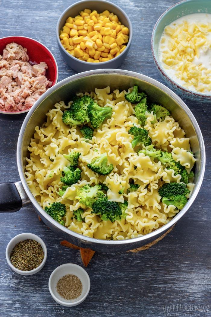 Tuna casserole ingredients - tuna, pasta, broccoli, cheese, herbs, salt and pepper
