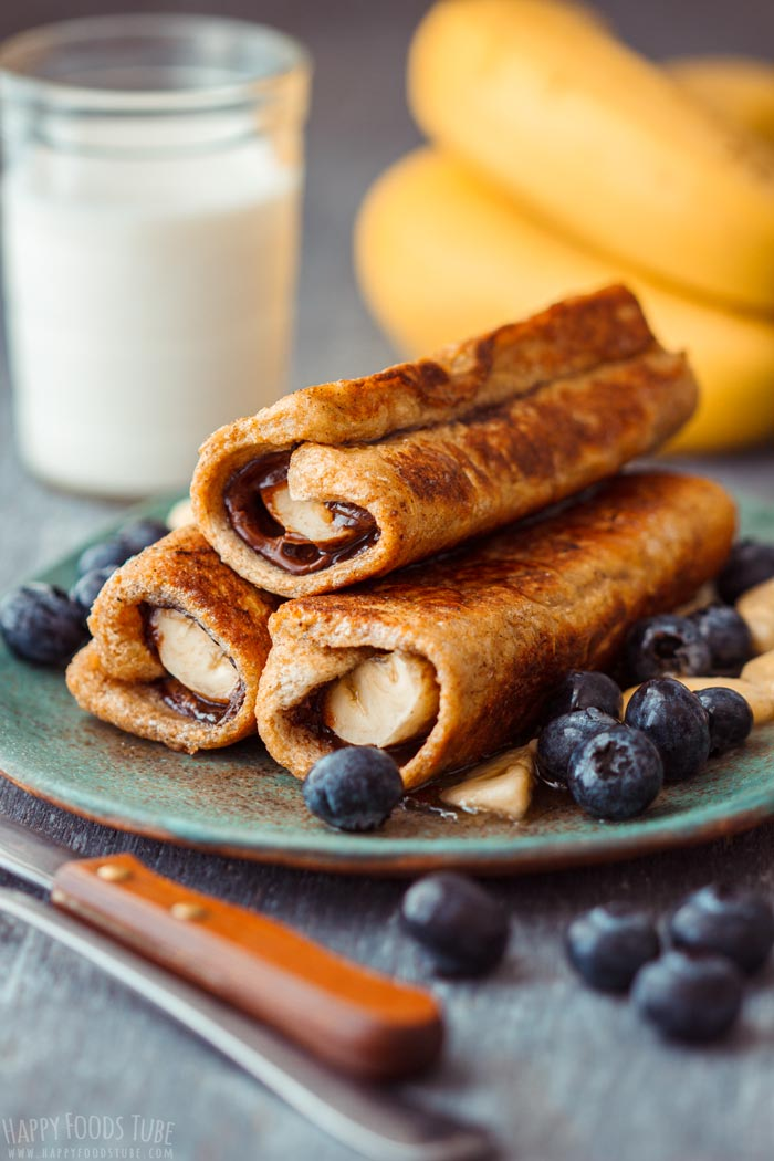 Nutella Banana French Toast Roll Ups with Blueberries and Honey Drizzle