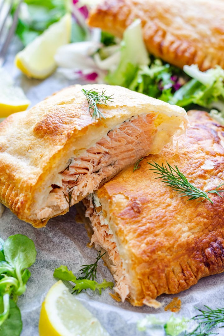 Freshly Made Salmon En Croute with Salad and Lemon Wedge