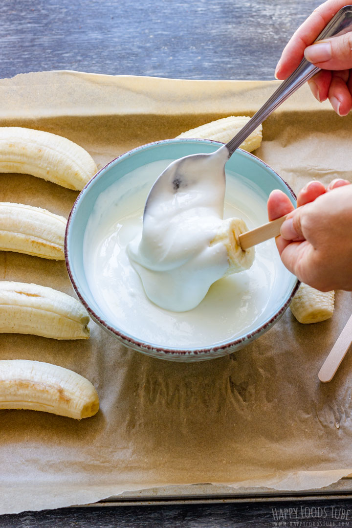 How to make Frozen Banana Pops Step 2 (Covering Bananas with Yogurt)