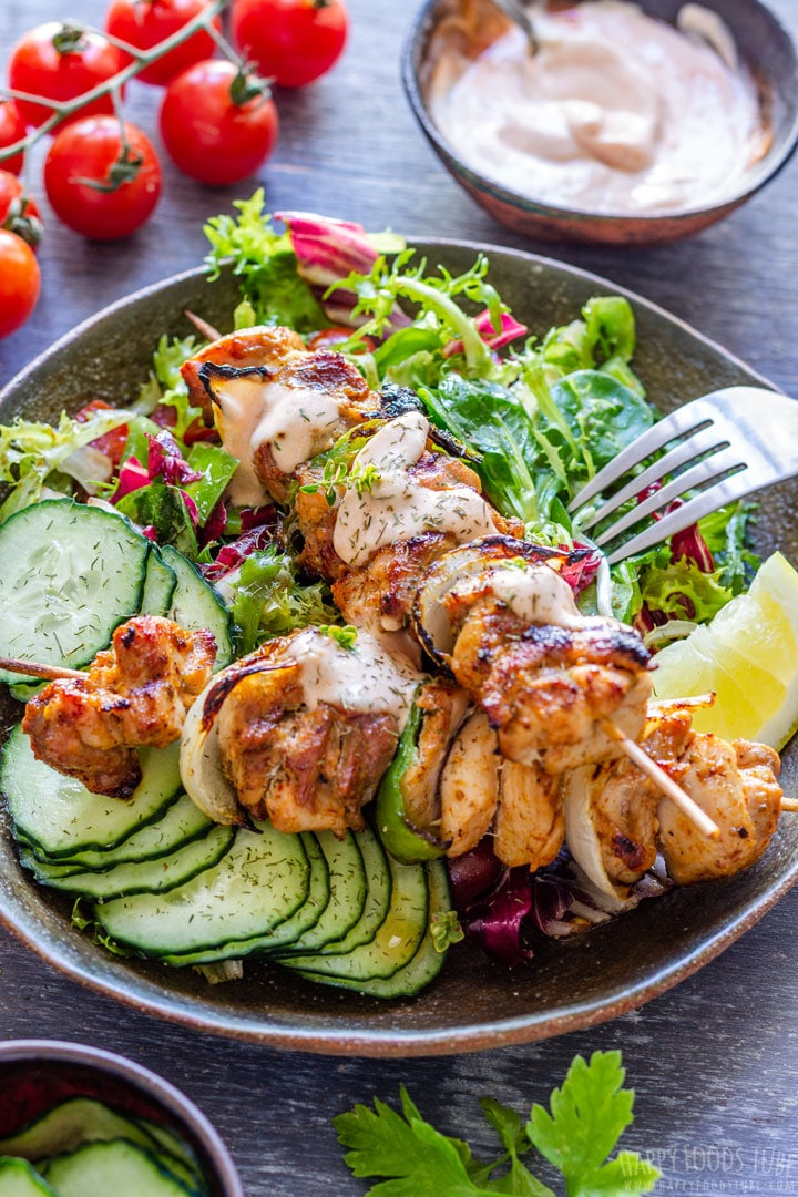 Grilled Chicken Kabobs with Fesh Salad on the Plate