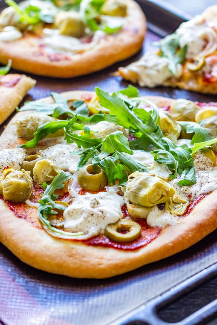 Burrata pizza with arugula and olives