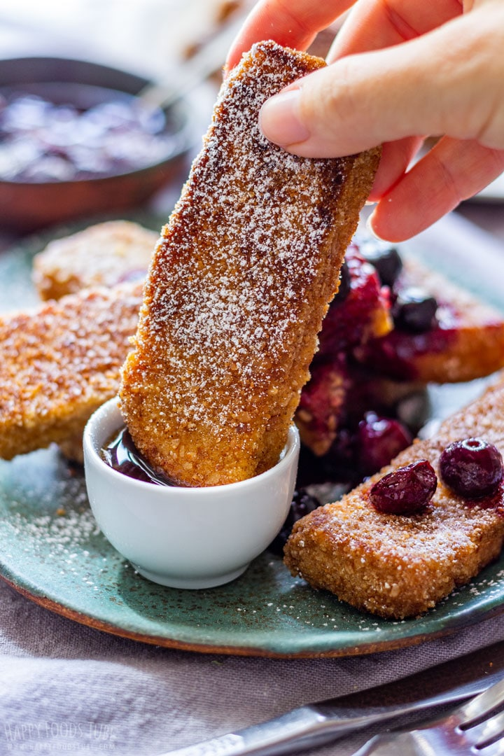 Dipping Homemade French Toast Sticks to Maple Syrup