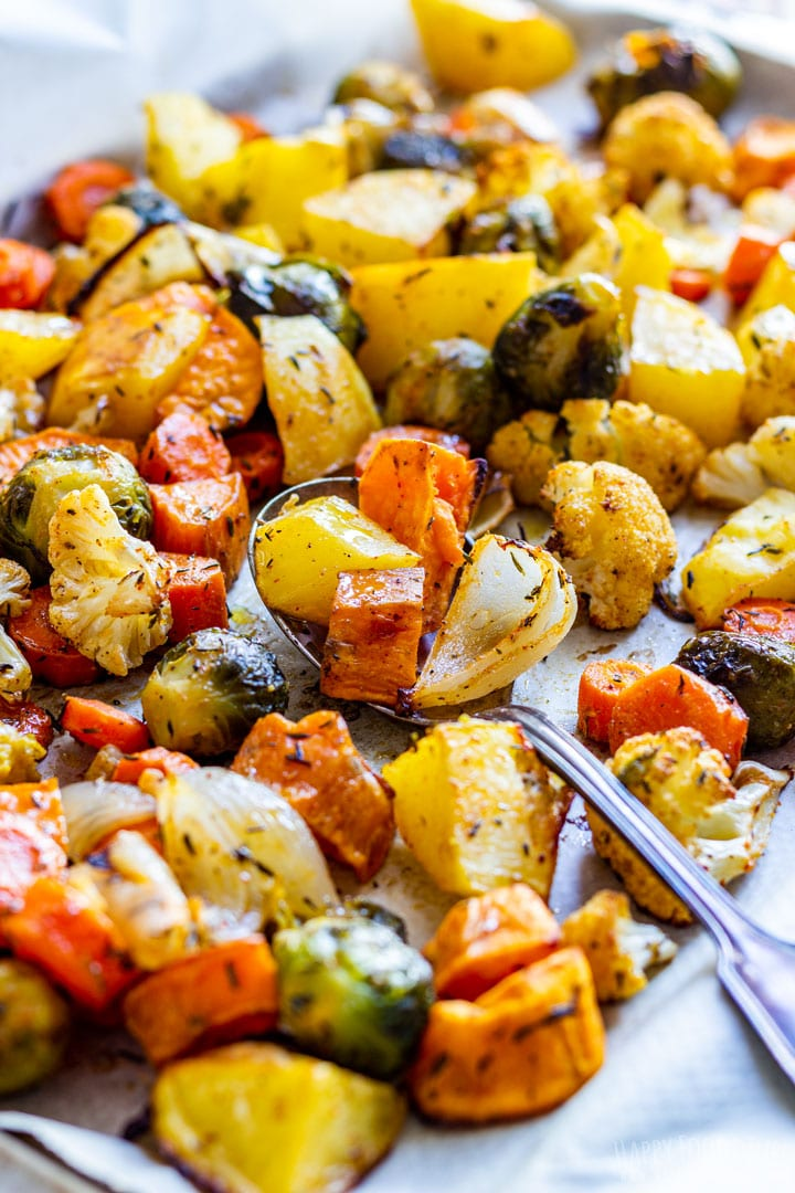 Colorful roasted fall vegetables on the baking tray