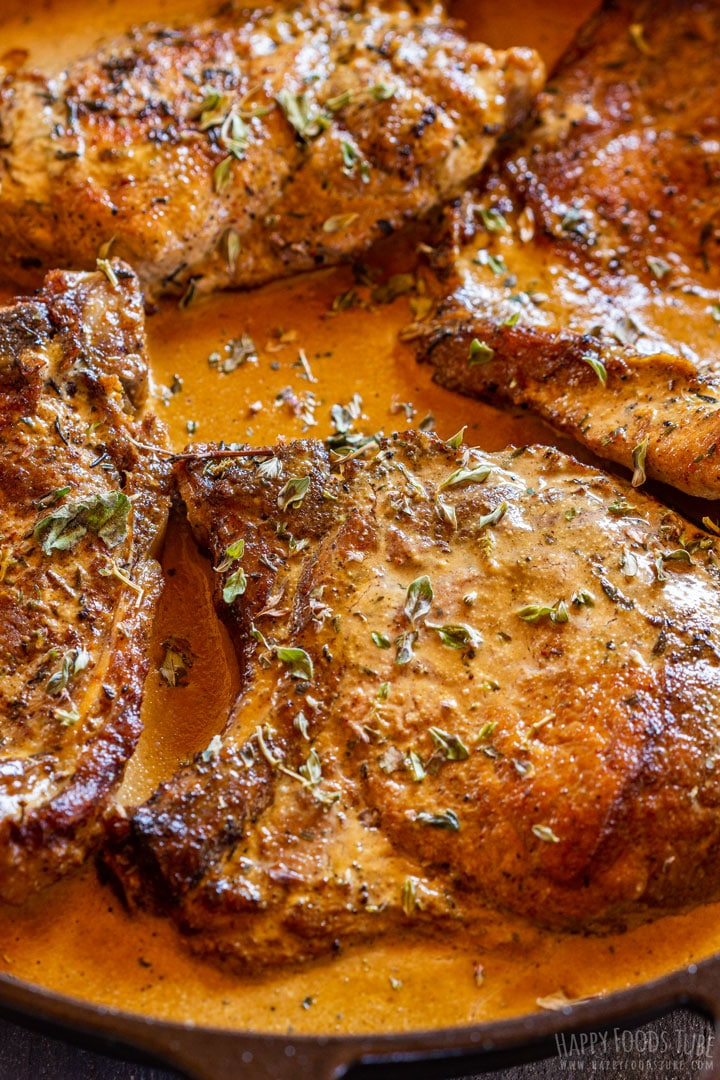 Tender pork chops with mustard sauce on the skillet
