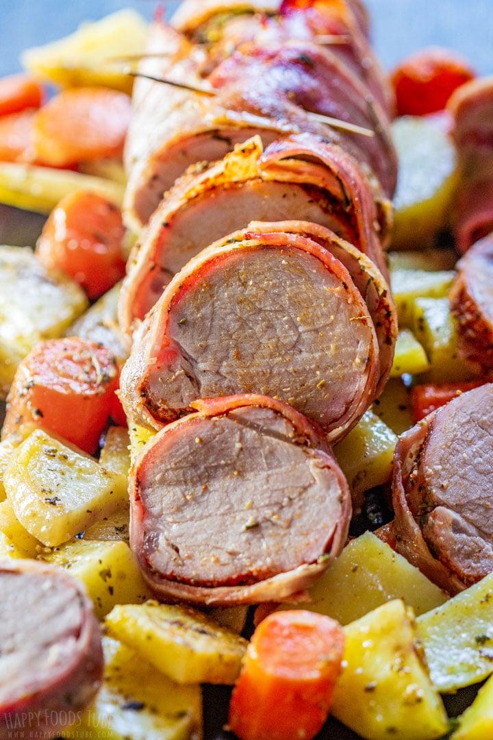 Sliced bacon wrapped pork tenderloin