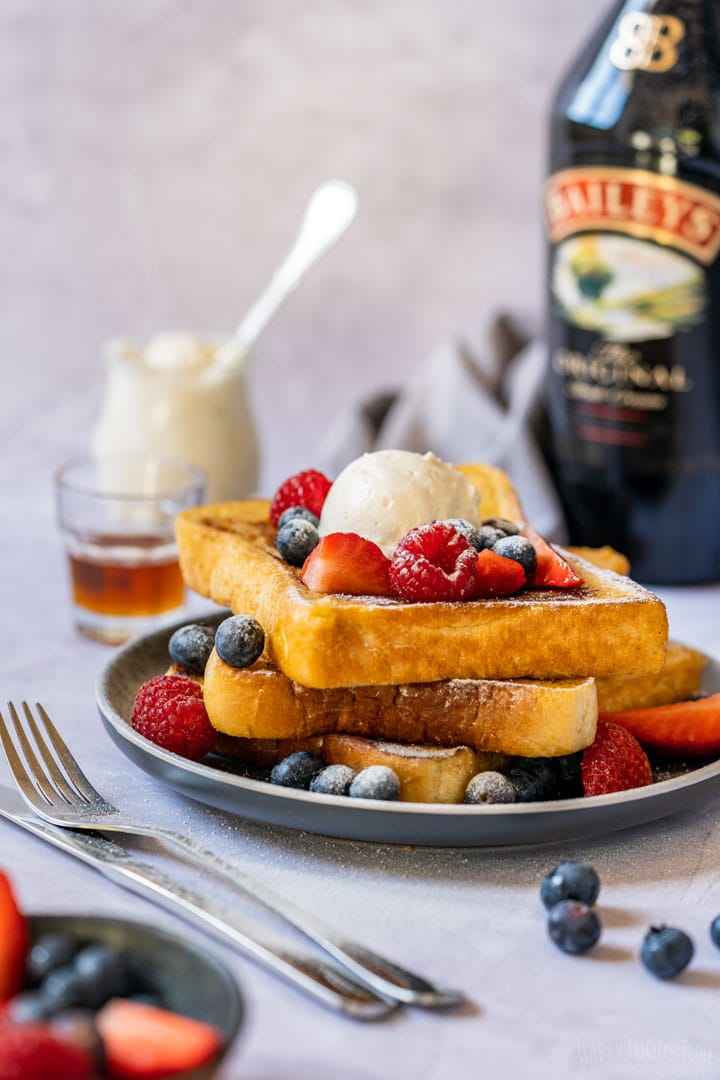 Baileys French toast topped with berries and whipped cream