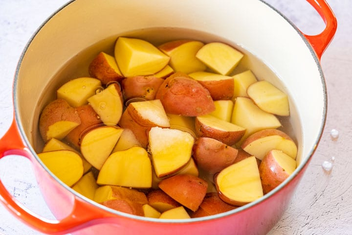 Boiling red potatos in a Duch oven for salad