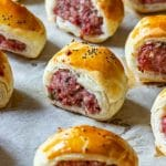 Homemade puff pastry sausage rolls on the baking tray